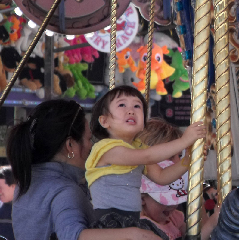 little girl on the merry go round